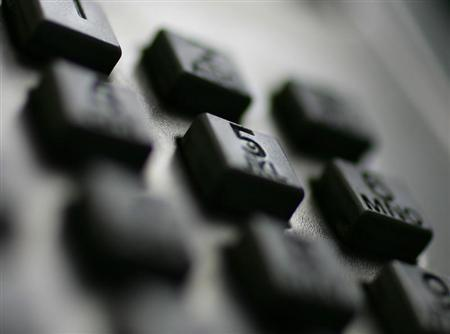 A keypad is seen on a public phone in a 2005 file photo. REUTERS/Tim Wimborne