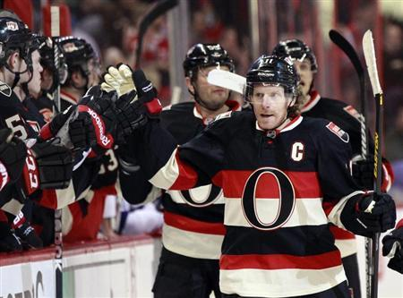 Ottawa Senators' captain Daniel Alfredsson celebrates his goal against the Tampa Bay Lightning during the first period of their NHL hockey game in Ottawa March 23, 2013. REUTERS/Blair Gable