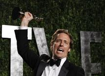 """Nat Faxon holds his award for Best Adapted Screenplay for """"The Descendants"""" at the 2012 Vanity Fair Oscar party in West Hollywood, California during the early morning of February 27, 2012. REUTERS/Danny Moloshok"""