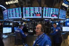 A trader works on the floor of the New York Stock Exchange as it closes for the week, July 5, 2013. REUTERS/Lucas Jackson
