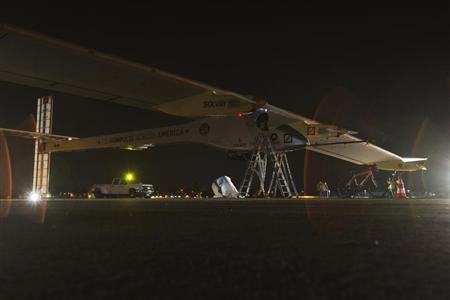 Solar Impulse aircraft sits on the Runway at Moffett Field before the the first leg of its 2013 Across America Mission in Mountain View, California May 3, 2013. REUTERS/Stephen Lam