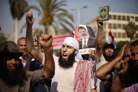 Supporters of deposed Egyptian President Mohamed Mursi shout slogans during a protest near Cairo University in Cairo July 6, 2013. REUTERS-Suhaib Salem