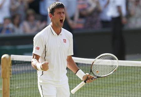 Novak Djokovic of Serbia celebrates after defeating Juan Martin del Potro of Argentina in their men's semi-final tennis match at the Wimbledon Tennis Championships, in London July 5, 2013. REUTERS/Suzanne Plunkett