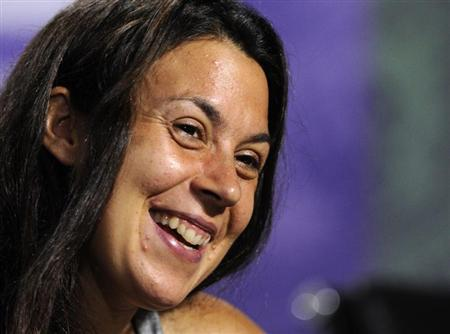 Marion Bartoli of France speaks at a news conference after defeating Sabine Lisicki of Germany in their women's singles final tennis match at the Wimbledon Tennis Championships, in London July 6, 2013. REUTERS/Thomas Lovelock/AELTC/Pool