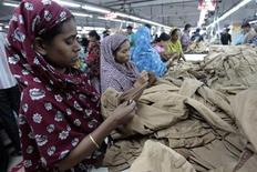 Women work at a garment factory in Savar July 27, 2012. REUTERS/Andrew Biraj