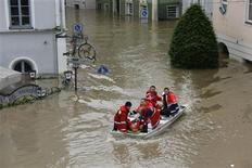 File picture shows a rescue team on a dinghy evacuating a man from the flooded district of the Bavarian town of Passau, about 200 km (124 miles) north-east of Munich June 4, 2013. REUTERS/Wolfgang Rattay/Files