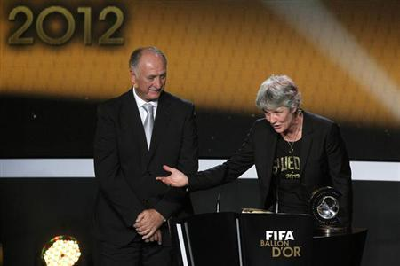 Brazil's national soccer coach Luiz Felipe Scolari (L) watches as Pia Sundhage of Sweden reacts after she is awarded as the FIFA Women Coach of the Year 2012 during the FIFA Ballon d'Or 2012 Gala at the Kongresshaus in Zurich January 7, 2013. REUTERS/Arnd Wiegmann