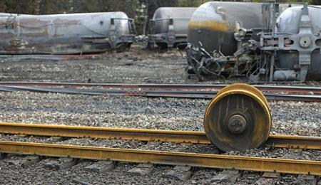 An axle gear from the train wreck is seen in Lac Megantic, July 9, 2013. The crude oil freight train that derailed and blew up in the small town of Lac-Megantic early on Saturday morning was traveling far too fast when it went off the rails, investigators told reporters on Tuesday. REUTERS/Mathieu Belanger