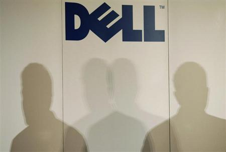 Shadows of Michael Dell, chairman of the board and chief executive officer of Dell, are cast under the company logo as he speaks during a press briefing in Tokyo March 24, 2009. REUTERS/Issei Kato