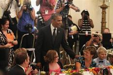 """U.S. President Barack Obama greets guests at the second annual """"Kids' State Dinner"""", to honor the winners of a nationwide recipe challenge to promote healthy lunches, at the White House in Washington July 9, 2013. REUTERS/Yuri Gripas"""