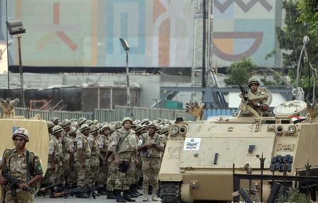 Egyptian army soldiers stand guard in front of the Egyptian museum in Cairo, July 9, 2013. REUTERS/Asmaa Waguih