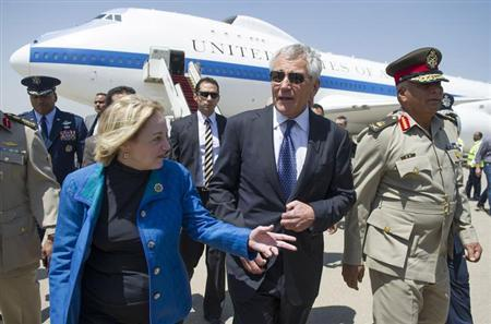 U.S. Defense Secretary Chuck Hagel (C) speaks with U.S. Ambassador to Egypt Anne Patterson and Egyptian Army Chief of Staff Major General Sedki Sobhi (R) upon his arrival in Cairo April 24, 2013. REUTERS/Jim Watson/Pool