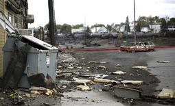 Debris from the explosion of a train are seen in Lac Megantic, July 9, 2013. REUTERS/Mathieu Belanger