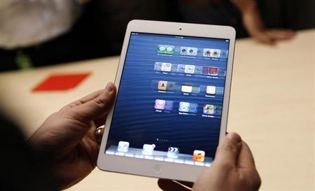 A visitor looks over the new iPad mini at an Apple event in San Jose, California October 23, 2012. REUTERS/Robert Galbraith/Files