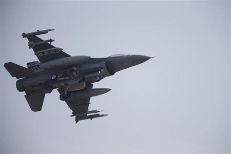 A F-16 fighter jet belonging to the U.S. Air Force comes in for a landing at a U.S. air force base in Osan, south of Seoul April 3, 2013. REUTERS/Lee Jae-Won