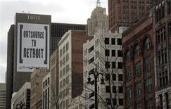 """A larger banner reading """"Outsource to Detroit"""" is seen on the side of a building on Woodward Ave in downtown Detroit, Michigan, January 7, 2012. REUTERS/Rebecca Cook"""