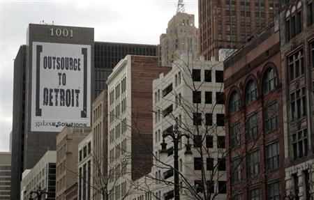 A larger banner reading ''Outsource to Detroit'' is seen on the side of a building on Woodward Ave in downtown Detroit, Michigan, January 7, 2012. REUTERS/Rebecca Cook