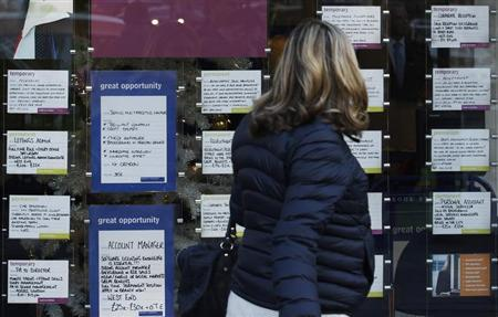 A woman passes a recruitment centre in London December 14, 2011. REUTERS/Luke MacGregor