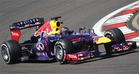 Red Bull Formula One driver Sebastian Vettel of Germany takes a corner during the German F1 Grand Prix at the Nuerburgring circuit July 7, 2013. REUTERS/Wolfgang Rattay