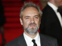 """Director Sam Mendes arrives for the royal world premiere of the new 007 film """"Skyfall"""" at the Royal Albert Hall in London October 23, 2012. REUTERS/Suzanne Plunkett"""
