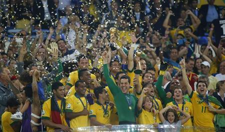 Brazil's players celebrate on the podium with the trophy after winning the Confederations Cup final match against Spain at the Estadio Maracana in Rio de Janeiro June 30, 2013. REUTERS/Kai Pfaffenbach