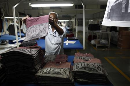 An employee sorts newly finished T-shirts at the Estee garment factory in Tirupur in the southern Indian state of Tamil Nadu June 19, 2013. REUTERS/Mansi Thapliyal