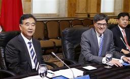 U.S. Secretary of Treasury Jacob Lew (C) and China's Vice Premier Wang Yang (L) sit before the start of a China Strategic and Economic Dialogue meeting at the U.S. Treasury Department in Washington, July 11, 2013. REUTERS/Larry Downing