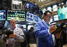 Traders work on the floor at the New York Stock Exchange July 10, 2013. REUTERS/Brendan McDermid