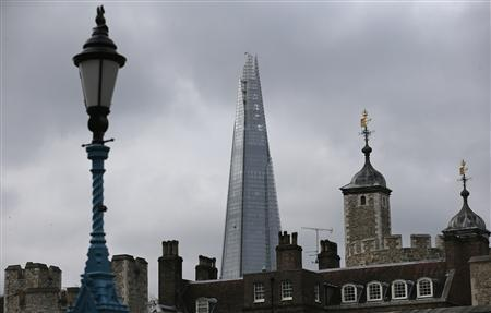The Shard, western Europe's tallest building, is seen behind Tower of London in London February 28, 2013. REUTERS/Suzanne Plunkett