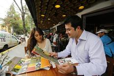 Tatiana (L), a licensing compliance expert at software firm, and her partner Josue, a manager in a business development firm, have breakfast at a restaurant in an upscale neighborhood in Mexico City July 7, 2013. REUTERS/Bernardo Montoya