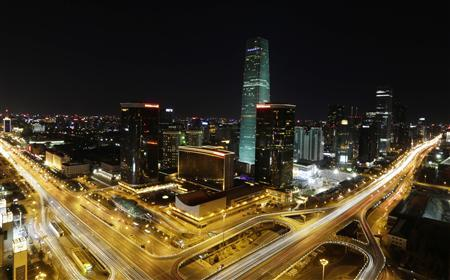 A general view of the China World Trade Centre Tower III is seen before Earth Hour in Beijing's central business district March 23, 2013. REUTERS/Jason Lee