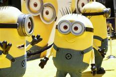 "Minion characters pose on the yellow carpet arrivals area at the American premiere of the animated film ""Despicable Me 2"" at Universal CityWalk and Gibson Amphitheatre in Universal City, California June 22, 2013. REUTERS/Danny Moloshok"