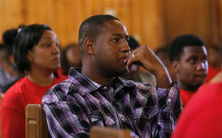 Members of the congregation listen as Pastor Valarie J. Houston makes a statement about the not guilty verdict for George Zimmerman at the Allen Chapel AME Church in Sanford, Florida, July 14, 2013. REUTERS/Joe Skipper