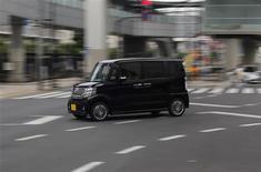 Honda Motor Co's N Box minicar goes on a street in Tokyo July 13, 2013. REUTERS/Toru Hanai