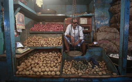 A vendor waits for customers at his stall at a wholesale food market in Mumbai July 15, 2013. REUTERS/Danish Siddiqui