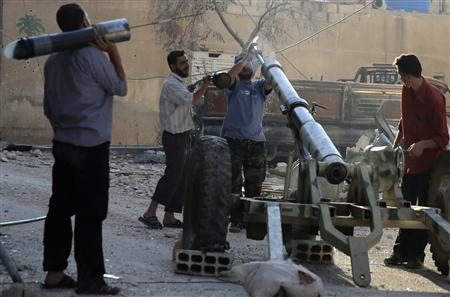 Free Syrian Army fighters prepare a mortar after what activists said were clashes between government forces and the Free Syrian Army in Damascus July 14, 2013. REUTERS/Mohamed Abdullah