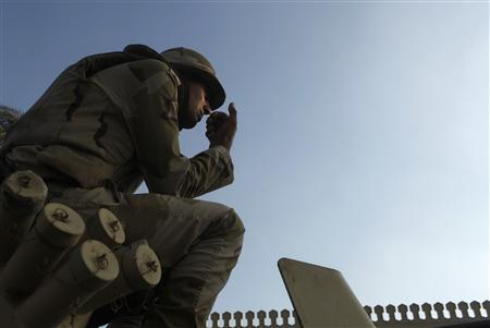 An Egyptian soldier keeps watch from atop a military vehicle in front of the presidential palace in Cairo July 14, 2013. REUTERS/Asmaa Waguih