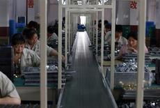 La Chine a créé 7,25 millions d'emplois au premier semestre 2013, soit un peu plus que sur la même période en 2012. /Photo prise le 24 mai 2013/REUTERS/William Hong