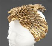 """A falcon headdress worn by Elizabeth Taylor in the 1963 film """"Cleopatra"""" is pictured in this undated handout photograph released to Reuters by Julien's Auctions July 15, 2013. REUTERS/Courtesy Julien's Auctions/Handout via Reuters"""