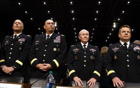 U.S. Army Generals stand ready to testify about pending legislation regarding sexual assaults in the military at a Senate Armed Services Committee on Capitol Hill in Washington, June 4, 2013. REUTERS/Larry Downing