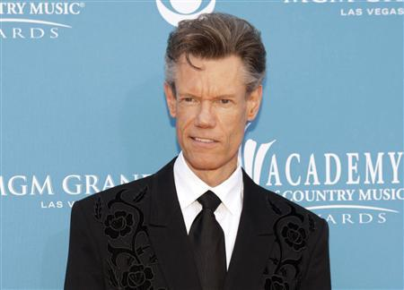 Singer Randy Travis arrives at the 45th annual Academy of Country Music Awards in Las Vegas, Nevada in this April 18, 2010 file photo. y to relieve pressure on his brain. He is in critical condition, according to a family spokesman. REUTERS/Steve Marcus/Files
