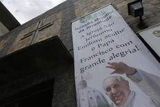 A banner promoting World Youth Day is seen at the Chapel of Sao Jeronimo, where Pope Francis is expected to visit during his upcoming trip to Varginha slum in Manguinhos slums complex in Rio de Janeiro July 16, 2013. REUTERS/Ricardo Moraes