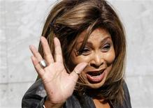 U.S. singer Tina Turner waves during a photocall before the Emporio Armani Autumn/Winter 2011 women's collection show at Milan Fashion Week February 26, 2011. REUTERS/Stefano Rellandini