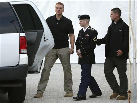 U.S. Army Private First Class Bradley Manning (C) is escorted out after a day of testimony at his court martial trial at Fort Meade, Maryland, July 8, 2013. REUTERS/Jonathan Ernst