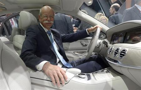 Dieter Zetsche, CEO of German carmaker Daimler, poses in a new Mercedes-Benz S-class car during a presentation in Hamburg, May 15, 2013. REUTERS/Fabian Bimmer
