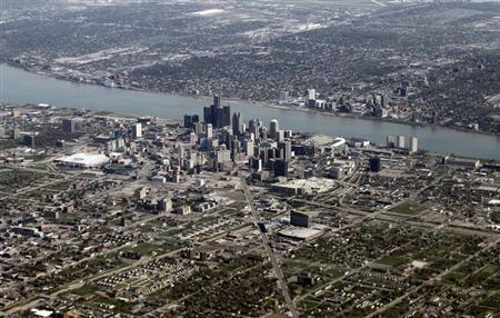 Detroit files for bankruptcy, stage set for court fight