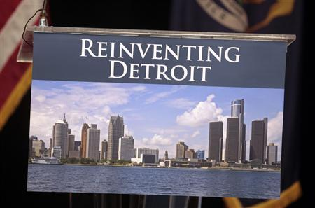 A image of the Detroit skyline is seen on the podium where Detroit Emergency Manager Kevyn Orr and Michigan Governor Rick Snyder will address the media about filing bankruptcy for the city of Detroit during a news conference in Detroit, Michigan July 19, 2013. REUTERS/ Rebecca Cook