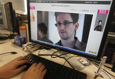 A picture of Edward Snowden, a contractor at the National Security Agency (NSA), is seen on a computer screen displaying a page of a Chinese news website, in Beijing in this June 13, 2013 photo illustration. REUTERS/Jason Lee/Files