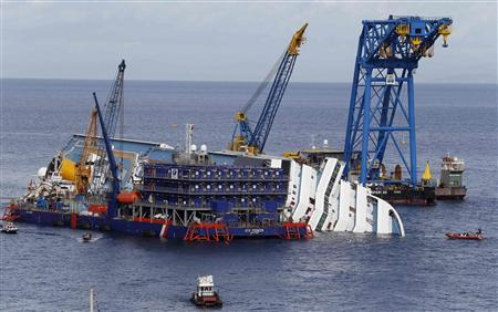 An overview during the rescue operation of the capsized cruise liner Costa Concordia surrounded by cranes in front of Giglio harbour in this November 6, 2012 file photo. REUTERS/Stefano Rellandini/Files