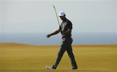 Tiger Woods of the U.S. walks across the 11th green during the third round of the British Open golf championship at Muirfield in Scotland July 20, 2013. REUTERS/Brian Snyder
